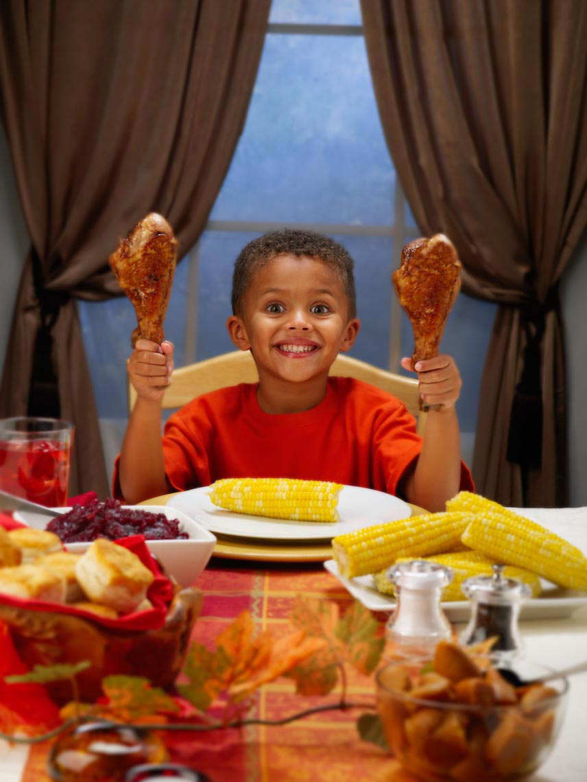 Lifestyle Photography | Boy holding turkey legs