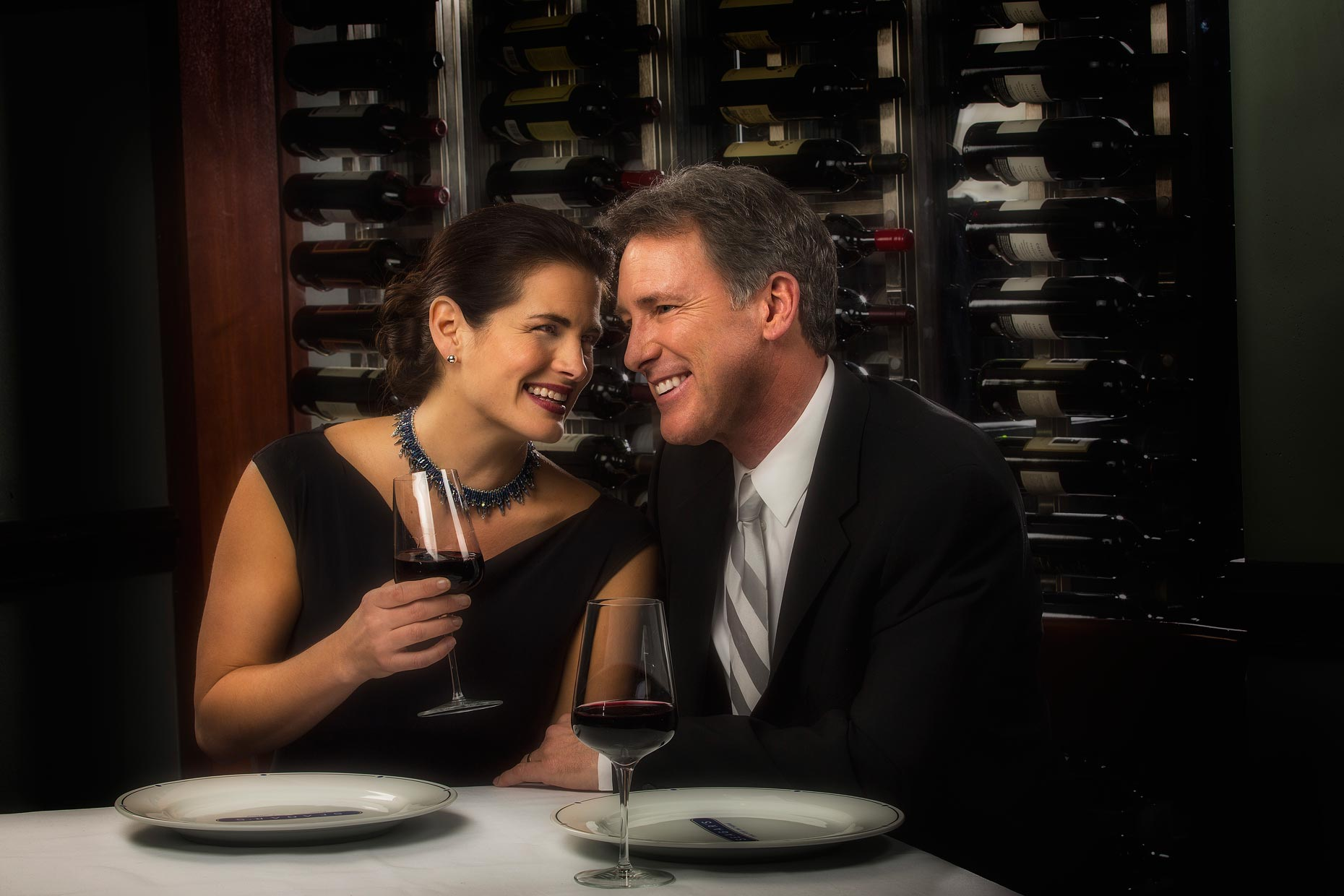 Lifestyle Photography | Hotel & Resort Photogrpapher|Couple drinking wine at Seagars RestaurantL