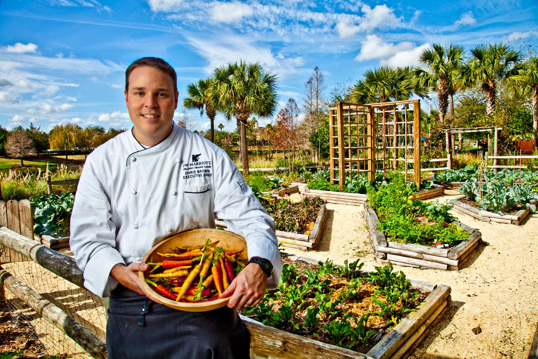 Chef Photogrpahy | Hotel & Resort Photogrpaher|Chef Holding Vegetable in Garden at J W Marriott Hotel