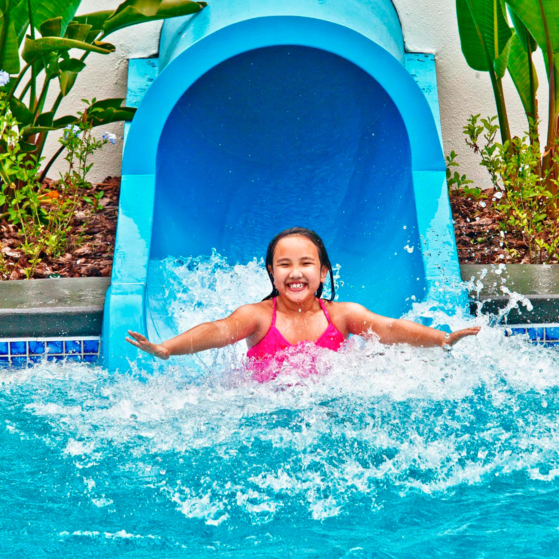 Lifestyle Photography | Hotel & Resort Photographer|Girl on Pool slide